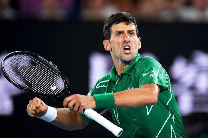 epa08178397 Novak Djokovic of Serbia reacts during his semi final match against Roger Federer of Switzerland at the Australian Open Grand Slam tennis tournament at Rod Laver Arena in Melbourne, Australia, 30 January 2020.  EPA/LUKAS COCH AUSTRALIA AND NEW ZEALAND OUT