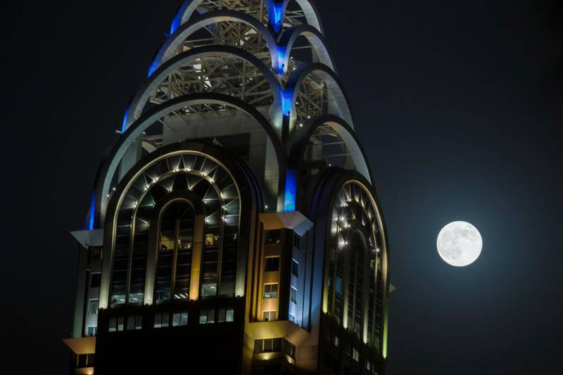 DUBAI, UNITED ARAB EMIRATES, AUGUST 10, 2014. The super moon rises over Media City in Dubai. (Photo: Antonie Robertson/The National) Journalist: None.Section: National.