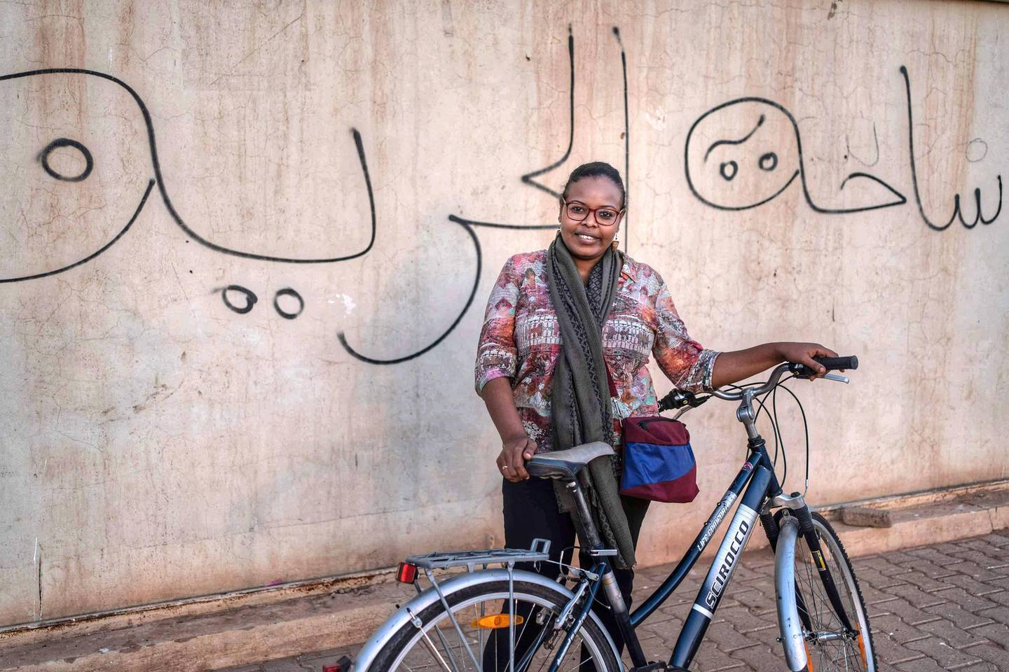 Enass Muzamel has launched a campaign in Khartoum to encourage women to cycle and free themselves from social limitations and taboos. Mrs Muzamel has been threatened to be lashed by young men for her initiative and for not wearing a headscarf. Courtesey: Enass Muzamel for The National