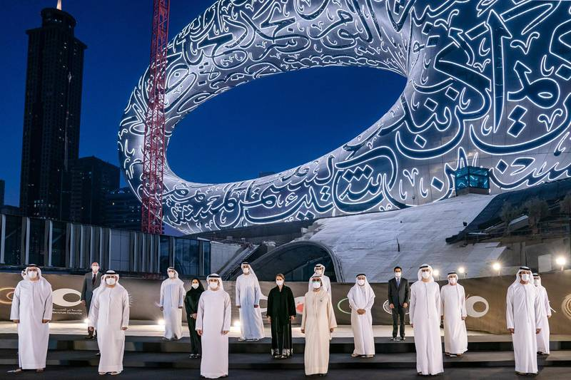 Sheikh Mohammed Bin Rashid, Vice-President and Prime Minister of the UAE and Ruler of Dubai, witnesses the installation of the final piece of façade of Museum of the Future. Seen with Sheikh Hamdan bin Mohammed bin Rashid Al Maktoum, Dubai Crown Prince and Chairman of The Executive Council of Dubai and Chairman of the Board of Trustees of Dubai Future Foundation; and Sheikh Maktoum bin Mohammed bin Rashid Al Maktoum, Deputy Ruler of Dubai. Seen with Mohammad bin Abdullah Al Gergawi, Cabinet Member, Minister of Cabinet Affairs, and Vice Chairman of the Board of Trustees of Dubai Future Foundation and Sheikh Maktoum bin Mohammed bin Rashid Al Maktoum, Deputy Ruler of Dubai. Sheikh Mohammed was accompanied during his tour of the museum by HH Sheikh Hamdan bin Mohammed bin Rashid Al Maktoum, Dubai Crown Prince and Chairman of The Executive Council of Dubai and Chairman of the Board of Trustees of Dubai Future Foundation; HH Sheikh Maktoum bin Mohammed bin Rashid Al Maktoum, Deputy Ruler of Dubai; and Mohammad bin Abdullah Al Gergawi, Cabinet Member, Minister of Cabinet Affairs, and Vice Chairman of the Board of Trustees of Dubai Future Foundation. Courtesy Museum of the Future