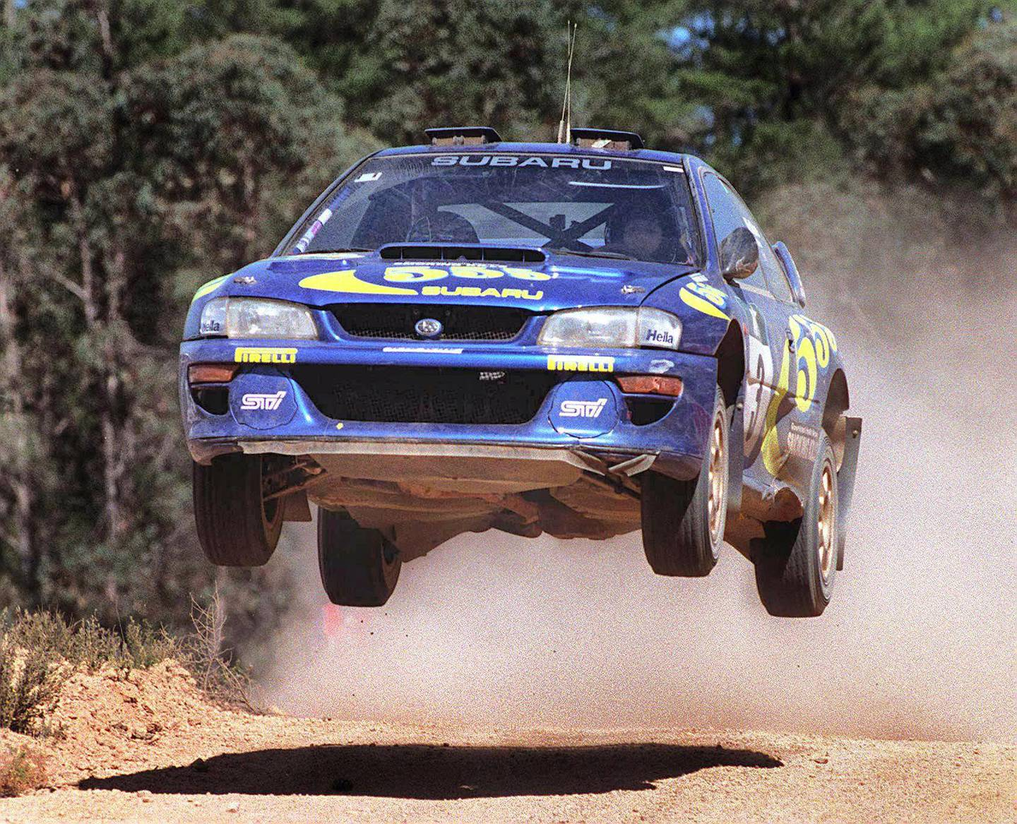 Colin McRae of Great Britain in full flight on his way to winning Rally Australia in Perth 02 November.  McRae won by six seconds over defending World Champion Tommi Makinen of Finland.  McRae's overall time was four hours, five minutes and 31 seconds.  AFP PHOTO / AFP PHOTO / GREG WOOD