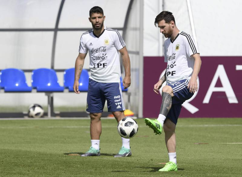Argentina's forward Lionel Messi (R) passes the ball next to teammate forward Sergio Aguero during a training session at the team's base camp in Bronnitsy, on June 25, 2018 on the eve of the team's third game as part of the Russia 2018 World Cup Group D football match. / AFP / JUAN MABROMATA