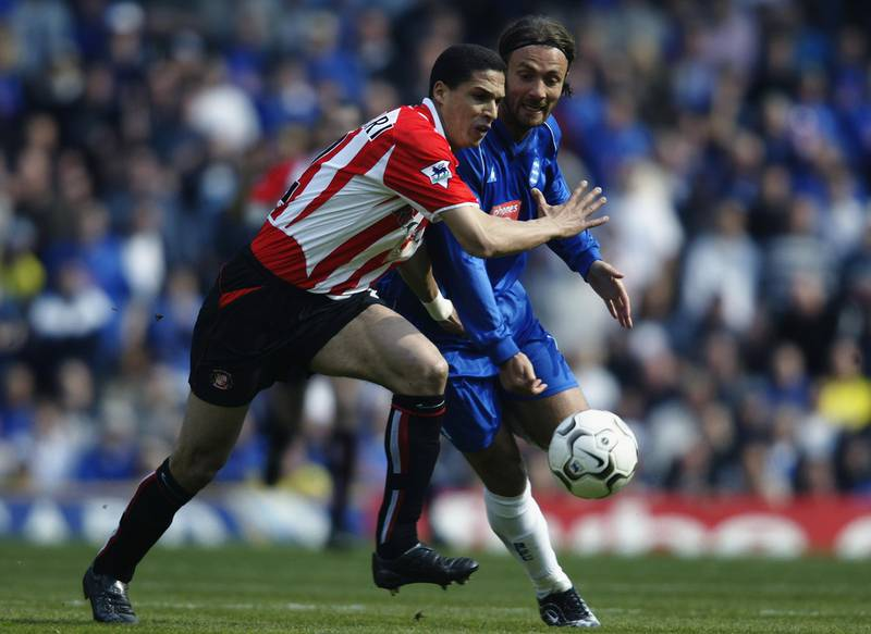 BIRMINGHAM - APRIL 12:  Christophe Dugarry of Birmingham City has his route forward blocked off by Talal El Karkouri of Sunderland during the FA Barclaycard Premiership match held on April 12, 2003 at St Andrews, in Birmingham, England. Birmingham City won the match 2-0. (Photo by Gary M. Prior/Getty Images)