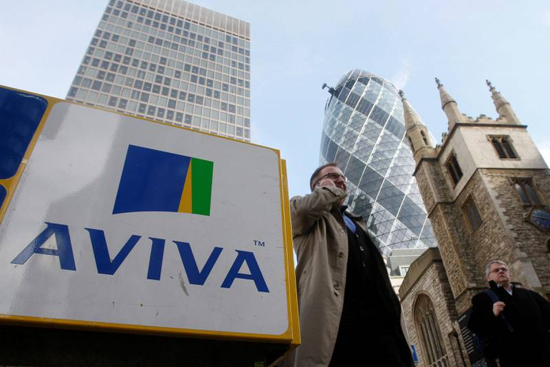 FILE PHOTO: Pedestrians walk past an Aviva logo outside the company's head office in the city of London, Britain March 5, 2009.  REUTERS/Stephen Hird/File Photo