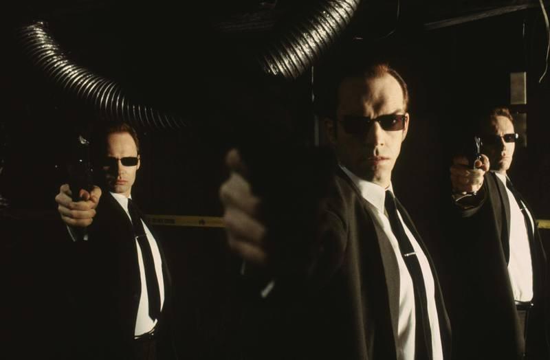 Hugo Weaving, Robert Taylor and Paul Goddard in The Matrix. Courtesy Warner Bros.