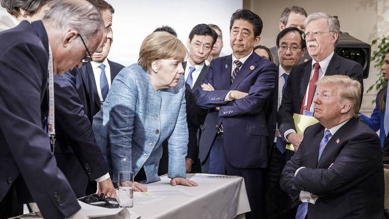 An image that illustrates this article Merkel's successor must fill big shoes on world stage yet foreign policy is absent