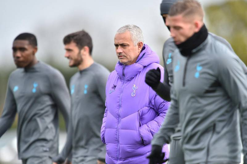 Tottenham Hotspur's Portuguese head coach Jose Mourinho (C) attends a team training session at Tottenham Hotspur's Enfield Training Centre, in north London on March 9, 2020, ahead of their UEFA Champions League Last 16 second-leg football match against RB Leipzig. (Photo by Glyn KIRK / AFP)