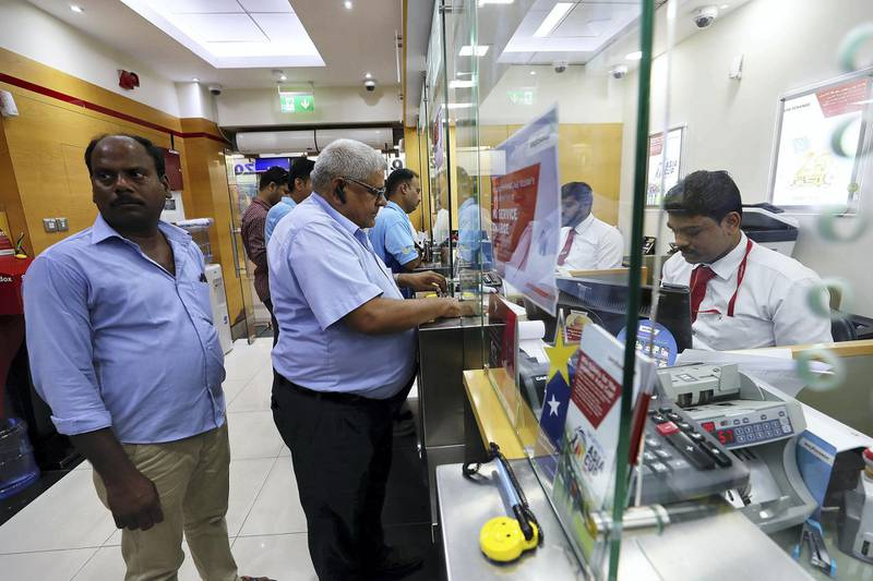 DUBAI, UNITED ARAB EMIRATES, August 30 – 2018 :-  Indian expats sending money back home from UAE exchange at the Al Quoz Mall in Al Quoz Industrial area in Dubai. Indian rupee hitting another record low of 19.22 against the UAE dirham on Wednesday.  ( Pawan Singh / The National )  For News. Story by Ramola