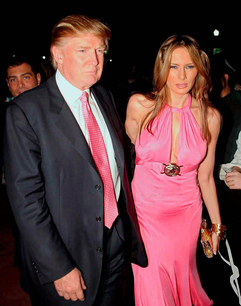 epa000383687 Donald Trump and his wife Melania Knauss arrive at the birthday party of Miami Heat player, Shaquille O'Neal at Hotel Victoria in Miami Beach, Florida, United States on Saturday 05 March 2005. Cuban music producer Emilo Estefan, Heat players Damon Jones and Eddie Jones and baseball player, Dominican Sammy Sosa also attended the party.  EPA/fotomiami