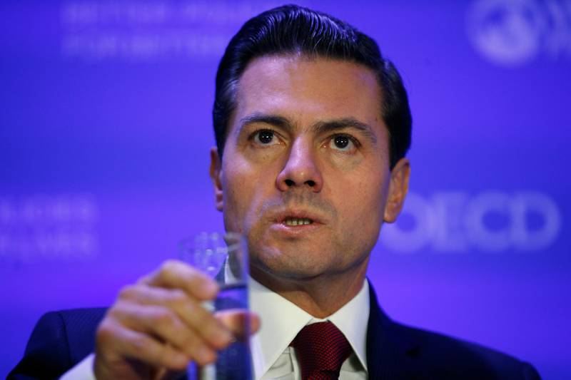 Mexico's President Enrique Pena Nieto, attends a conference, at the OECD headquarters, in Paris, Monday, Dec. 11, 2017. Pena Nieto has drawn scorn on the internet after making a grade-school grammar mistake that his office corrected in an official transcript of his remarks. (AP Photo/Thibault Camus)