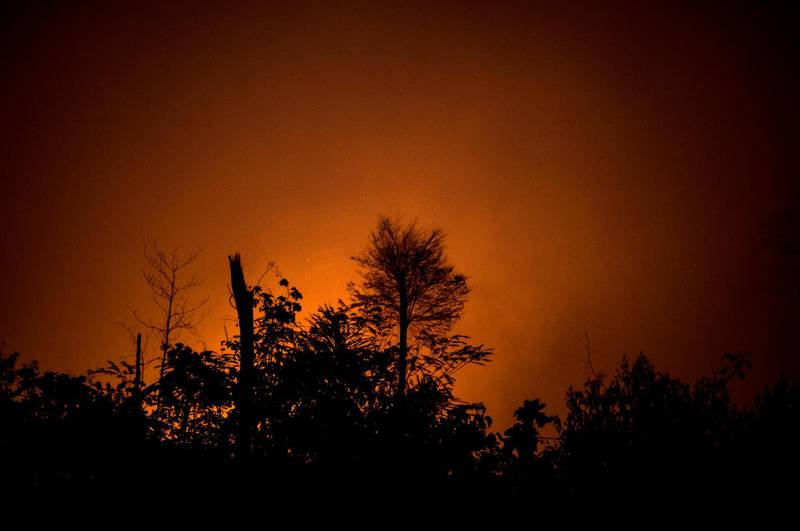 Fire burns in the Amazon rainforest in Porto Velho, Rondonia state, Brazil, on Saturday, Aug. 24, 2019. The world's largest rainforest, Brazil's Amazon, is burning at a record rate, according to data from the National Institute of Space Research that intensified domestic and international scrutiny of President Jair Bolsonaro's environmental policies. Photographer: Leonardo Carrato/Bloomberg