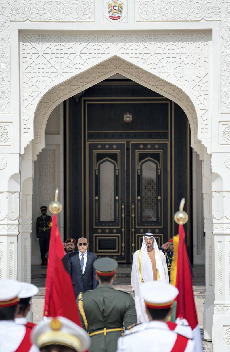 ABU DHABI, UNITED ARAB EMIRATES - February 02, 2020: HH Sheikh Mohamed bin Zayed Al Nahyan, Crown Prince of Abu Dhabi and Deputy Supreme Commander of the UAE Armed Forces (R) and HE Mohamed Ould Ghazouani, President of Mauritania (L), stand for the national anthem during an official visit at Qasr Al Watan.   ( Rashed Al Mansoori / Ministry of Presidential Affairs ) ---
