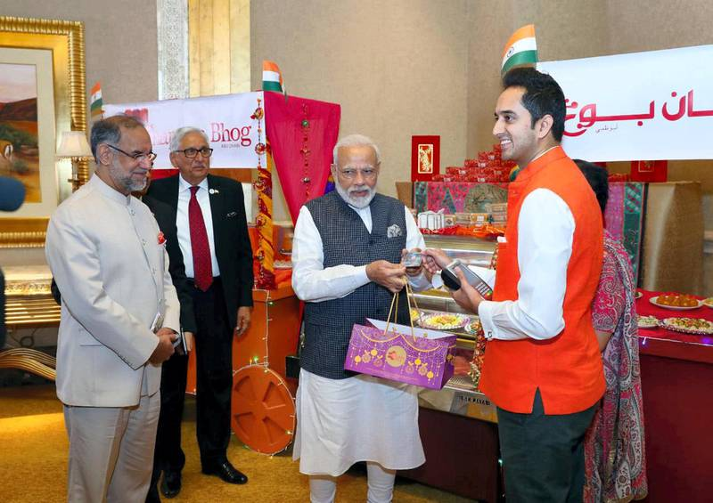 Modi visit to Emirates Palace this morning, paying for sweets with the new RuPay card.