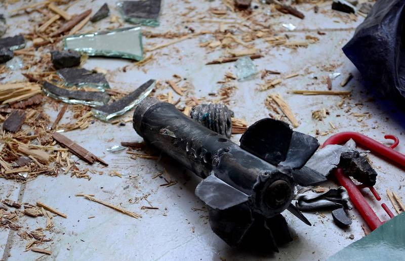 """A handout picture released by the official Syrian Arab News Agency (SANA) on October 31, 2013, shows the remains of a mortar after an alleged mortar attack by rebel fighters on the Damascus mixed Christian-Druze suburb of Jaramana. Syria's entire declared stock of chemical weapons has been placed under seal, a watchdog said, as peace envoy Lakhdar Brahimi wrapped up a Syria visit to muster support for peace talks. AFP PHOTO / SANA --- RESTRICTED TO EDITORIAL USE - MANDATORY CREDIT """"AFP PHOTO / SANA"""" - NO MARKETING NO ADVERTISING CAMPAIGNS - DISTRIBUTED AS A SERVICE TO CLIENTS --- (Photo by - / SANA / AFP)"""