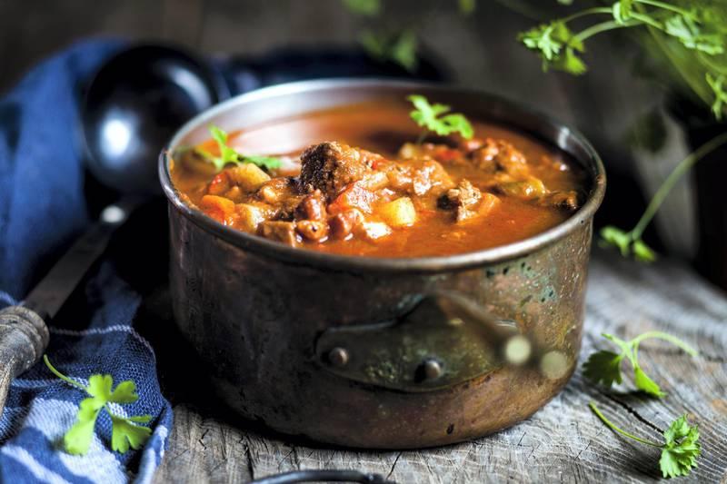 Goulash soup with flat leaf parsley