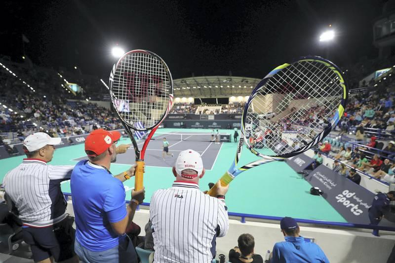 Abu Dhabi, United Arab Emirates - Reporter: Jon Turner: Fans with giant rackets during the final between Rafael Nadal v Stefanos Tsitsipas at the Mubadala World Tennis Championship. Saturday, December 21st, 2019. Zayed Sports City, Abu Dhabi. Chris Whiteoak / The National