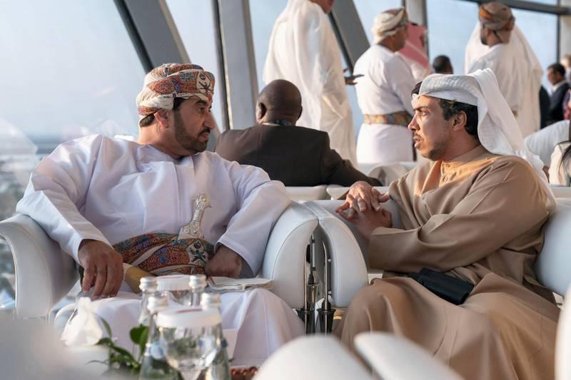 YAS ISLAND, ABU DHABI, UNITED ARAB EMIRATES - December 01, 2019: HE Sayyid Khalid Bin Hilal Al Busaidi, Minister of Diwan of Royal Court of Oman (L) and HH Sheikh Mansour bin Zayed Al Nahyan, UAE Deputy Prime Minister and Minister of Presidential Affairs (R), attend the final day of the 2019 Formula 1 Etihad Airways Abu Dhabi Grand Prix, at Shams Tower.  ( Ryan Carter for the Ministry of Presidential Affairs ) ---