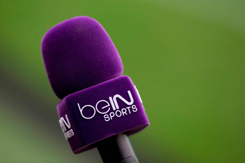 (FILES) This file picture taken on December 19, 2015 shows a microphone labelled with bein sports TV logo prior to the European Rugby Champions Cup match beetween Stade Francais Paris and Treviso, at Jean Bouin stadium in Paris. Like it or not, Egypt is having to resort to pricey beIN subscriptions to watch the national team, The Pharaohs, play in the World Cup for the first time in 28 years. / AFP / KENZO TRIBOUILLARD