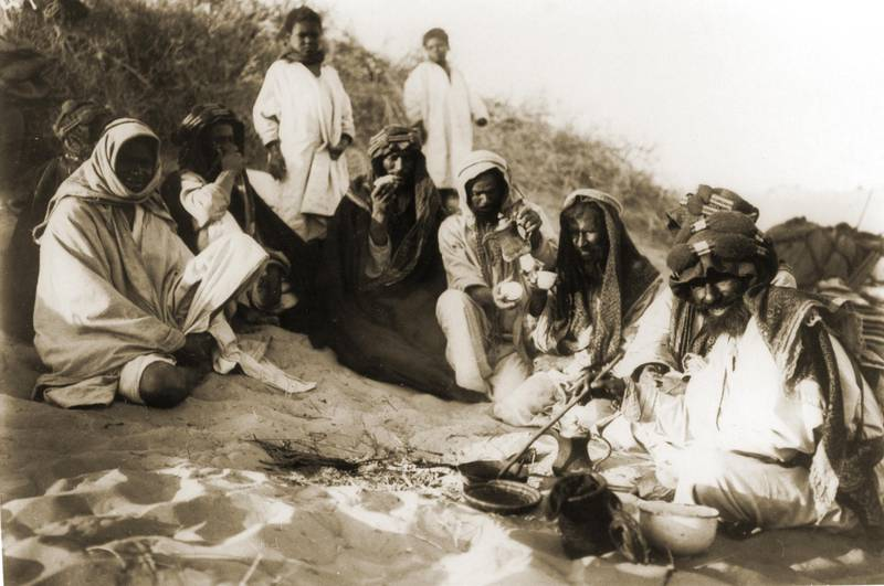 then a photo by traveler Hermann Burchardt of tribes pausing for coffee break in the desert between Hufuf and Qatar dating 1904  Courtesy National Center for Documentation and Research.