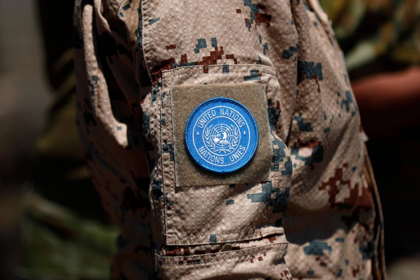 epa08675003 A United Nations patch on an UNDOF (United Nations Disengagement  Observer force) soldier's uniform at Ben Tal overlooking the Israeli-Syrian border, 17 August 2020 (issued 17 September 2020). The United Nations in the year 2020 mark the 75th anniversary, and some peacekeeping missions remain in the region as a reflection of the presence of UN in the Middle East, according to the UN. The United Nations Disengagement Observer Force (UNDOF) was established by the Security Council on 1974, the mandate is to maintain the ceasefire between the parties and supervise the disengagement of Israeli and Syrian forces as well as the so-called areas of separation (a demilitarized buffer zone) and limitation (where Israeli and Syrian troops and equipment are restricted) in the Golan Heights.  EPA/ATEF SAFADI