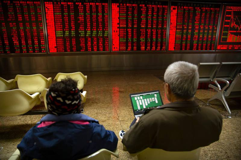 A Chinese investor uses a laptop as he monitors stock prices at a brokerage house in Beijing, Monday, Nov. 4, 2019. Asian stock markets followed Wall Street higher Monday after unexpectedly strong U.S. jobs data helped to soothe worries American factory activity was weaker than forecast. (AP Photo/Mark Schiefelbein)