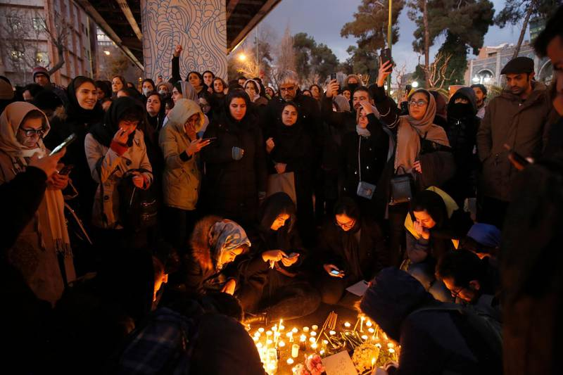 epa08120363 Iranians light candles for victims of Ukraine International Airlines Boeing 737-800 during as they protest in front of the Amir Kabir University in Tehran, Iran, 11 January 2020. Media reported that hundreds of Iranians protests in Tehran in solidarity with victims of the Ukraine plane as Iranian military released a statement claiming that Ukraine International Airlines flight PS752 was shot down due to human error.  EPA/ABEDIN TAHERKENAREH