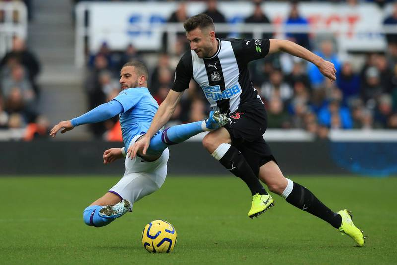 Manchester City's English defender Kyle Walker (L) vies with Newcastle United's Welsh defender Paul Dummett during the English Premier League football match between Newcastle United and Manchester City at St James' Park in Newcastle-upon-Tyne, north east England on November 30, 2019. (Photo by Lindsey Parnaby / AFP) / RESTRICTED TO EDITORIAL USE. No use with unauthorized audio, video, data, fixture lists, club/league logos or 'live' services. Online in-match use limited to 120 images. An additional 40 images may be used in extra time. No video emulation. Social media in-match use limited to 120 images. An additional 40 images may be used in extra time. No use in betting publications, games or single club/league/player publications. /