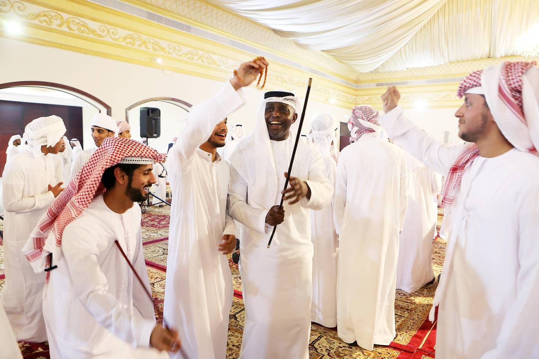 ABU DHABI , UNITED ARAB EMIRATES - JULY 5 : Bilal Antara Shadah Al Mazrouei ( center ) dancing with the guests during the local marriage celebration at Baniyas wedding hall in Abu Dhabi.  ( Pawan Singh / The National ) Story by Haneen Dajani