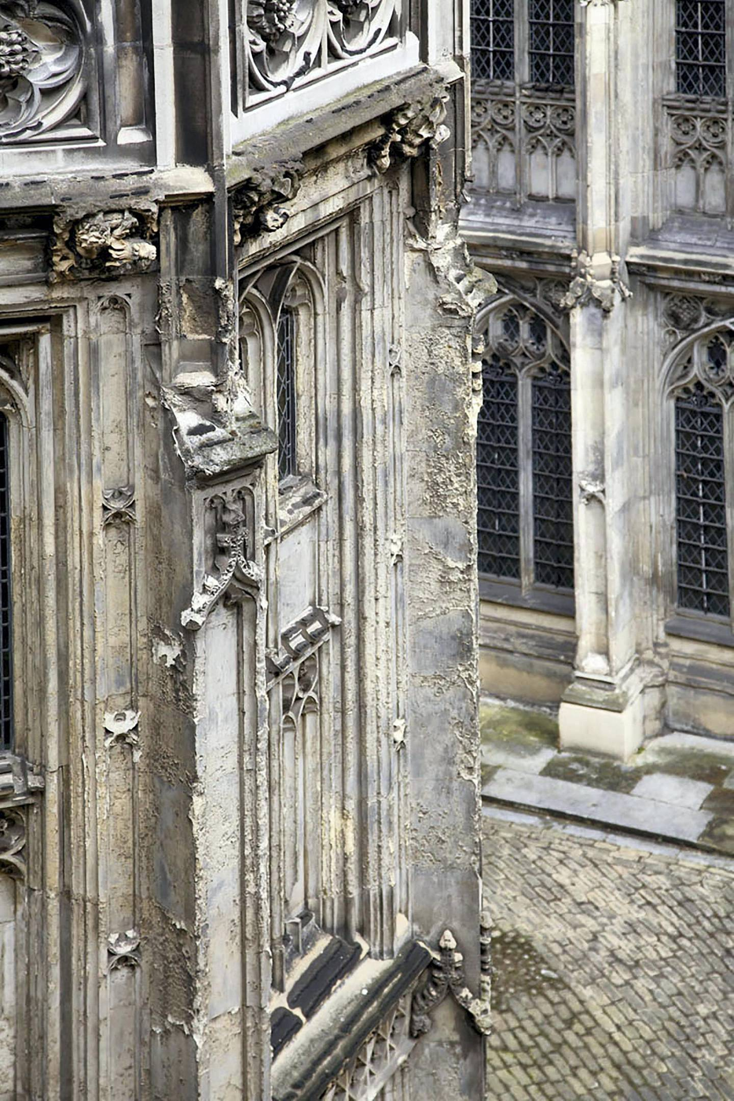 """A handout picture released by the UK Parliament on January 30, 2018 and taken on April 24, 2014 shows a view of general dilapidation of exterior stonework in Cloister Court at the Palace of Westminster in Londonin 2014. British lawmakers were set to deabte the proposed restoration of the Palace of Westminster, the historic palace that houses the UK Houses of Parliament. A parliamentary report published in 2016 recommended that lawmakers should move out of the crumbling building while it is renovated to avert a crisis. Behind its neo-Gothic facades topped by the world-famous Big Ben clock tower, the mother of parliaments has been eroded by air pollution, overrun with mice and crumbling, prompting warnings it may have to be permanently abandoned unless urgent renovations are carried out costing billions of pounds.  / AFP PHOTO / UK PARLIAMENT / HO / RESTRICTED TO EDITORIAL USE - MANDATORY CREDIT  """" AFP PHOTO / UK PARLIAMENT """"  -  NO MARKETING NO ADVERTISING CAMPAIGNS   -  DISTRIBUTED AS A SERVICE TO CLIENTS SPECIFICALLY TO ILLUSTRATE THE AFP STORY BY JOE JACKSON DATED JAN 31, 2018 -  NO ARCHIVE - RESTRICTED TO SUBSCRIPTION USE - NO SALES - NO USE ON ANY SOCIAL MEDIA PLATFORM - NOT TO BE ADAPTED ALTERED OR MANIPULATED  / TO GO WITH AFP STORY BY JOE JACKSON"""