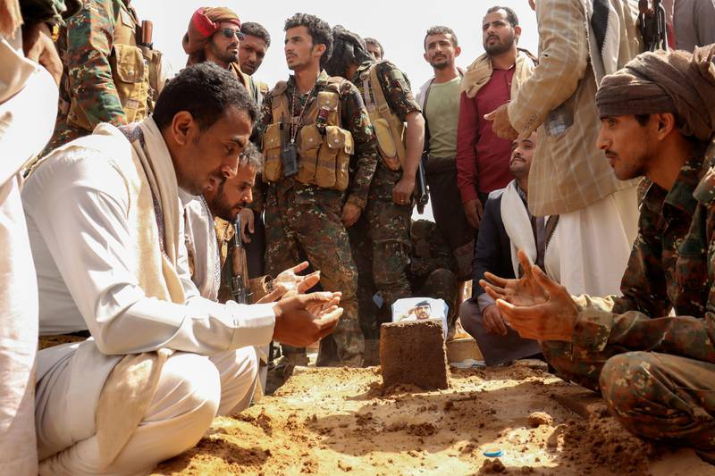 Soldiers recite prayers next to the grave of Brigadier General Abdul-Ghani Shaalan, Commander of the Special Security Forces in Marib who was killed in recent fighting with Houthi fighters in Marib, Yemen February 28, 2021. REUTERS/Ali Owidha