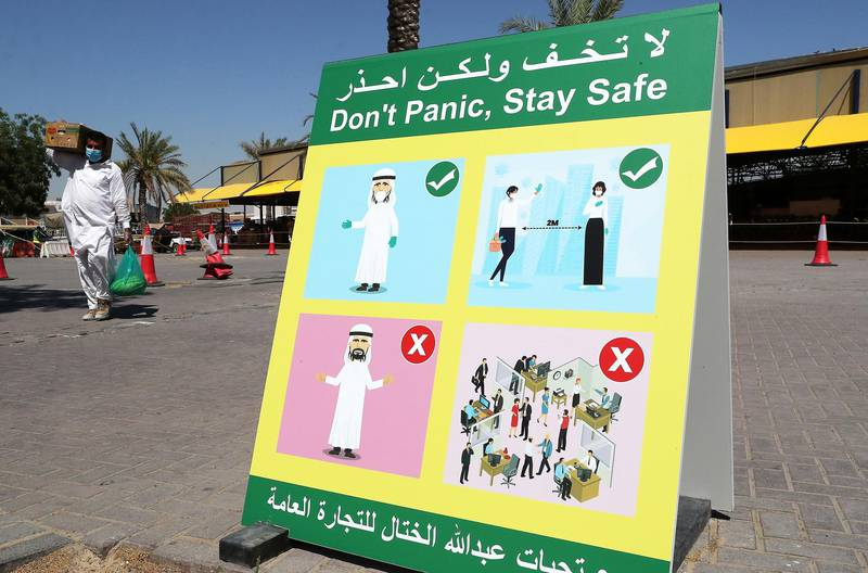 DUBAI, UNITED ARAB EMIRATES , May 5 – 2020 :- Don't Panic, Stay Safe signboard at the Al Awir fruit & vegetable market in Dubai. UAE government ease the coronavirus restriction for the residents around the country. (Pawan Singh / The National) For News/Standalone/Online/Stock
