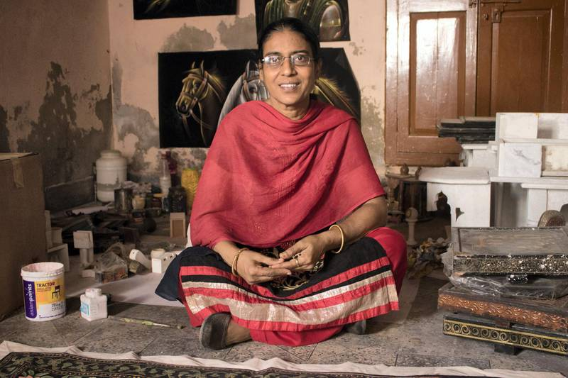 """: Rajni, Vaishnavdas' daughter, says, """"My father painted the Bani Thani in 1979 which we've kept in the workshop even today. Now, the artists can't give enough time to the fine art hand it shows in their work."""" Courtesy: Sanket Jain"""