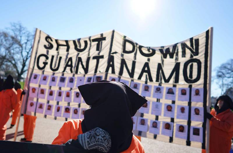 """(FILES) In this file photo taken on January 11, 2016 demonstrators take part in a protest calling for the closure of the Guantanamo Bay prison in front of the White House in Washington, DC.  US President Joe Biden wants to close the Guantanamo Bay prison for terror suspects before the end of his term, the White House said February 12,2021, echoing an unfulfilled campaign promise from Barack Obama's administration. Asked at a press conference about a possible closure of the prison in Cuba during Biden's tenure, spokeswoman Jen Psaki said, """"That certainly is our goal and our intention.""""  / AFP / MANDEL NGAN"""