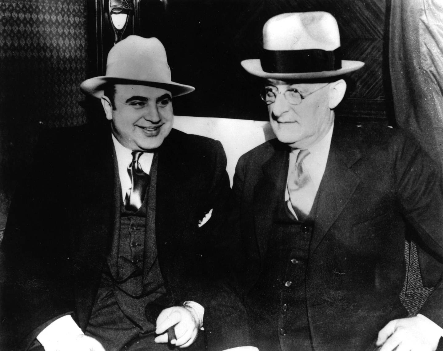 American gangster Al Capone (1899 - 1947) with US Marshall Laubenheimar.  Original Publication: People Disc - HC0216   (Photo by Keystone/Getty Images)