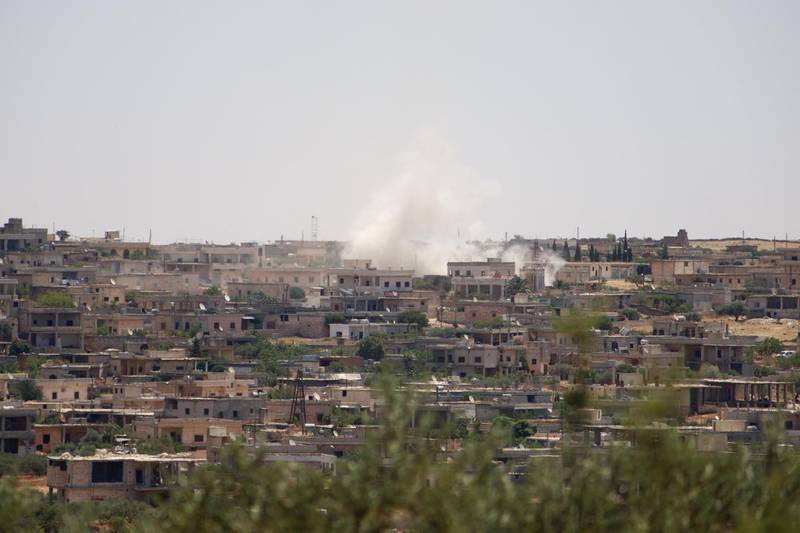 EDITORS NOTE: Graphic content / Smoke billows following reported bombardment by government forces in the Syrian northwestern town of Barah, in the Jabal al-Zawiya region of the rebel-held Idlib province on June 21, 2021. Syrian government shelling on the rebel-controlled enclave of Idlib killed at least nine people, including four civilians, a war monitor reported. / AFP / Abdulaziz KETAZ