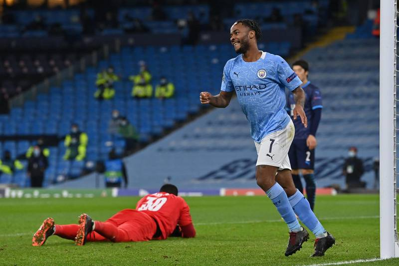 Manchester City's English midfielder Raheem Sterling celebrates scoring his team's third goal during the UEFA Champions League 1st round day 6 group C football match between Manchester City and Marseille at the Etihad Stadium in Manchester, north west England, on December 9, 2020.  / AFP / Paul ELLIS