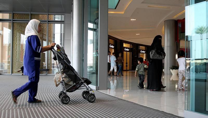 DUBAI, UNITED ARAB EMIRATES �� June 30: House maid with one of the family at Dubai Mall in Dubai. (Pawan Singh / The National) *** Local Caption ***  PS01- MAID.jpg