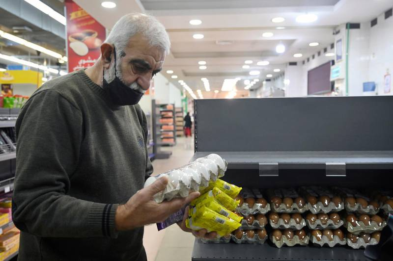 epa09093816 A customer looks at eggs price in a supermarket in Beirut, Lebanon, 24 March 2021. Calls circulated on media platforms asking all Lebanese not to buy eggs and chicken after their prices sky rocketed in a country witnessing a deep economic crisis. Inflation rate in Lebanon was at record high in December 2020 after food prices increased by up to 400 percent.  EPA/WAEL HAMZEH