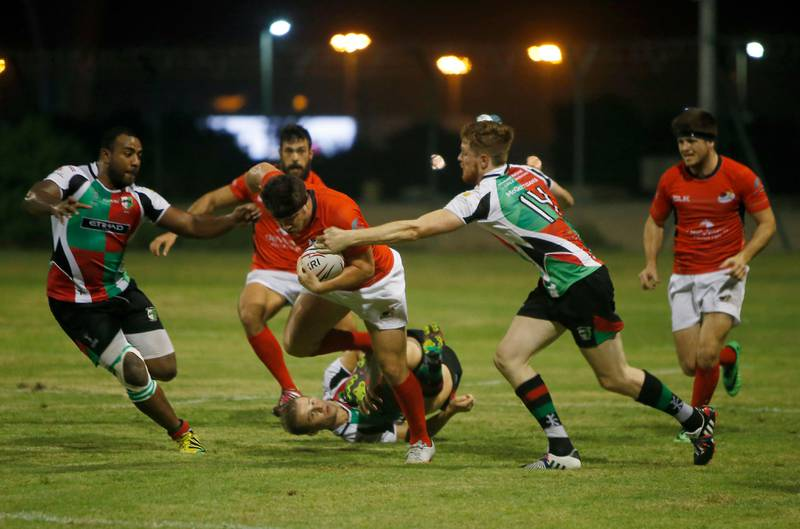 ABU DHABI - UNITED ARAB EMIRATES - 06OCT2016 - Abu Dhabi Saracens (in red) and Abu Dhabi Harlequins tussels for the ball in the West Asia Premiership rugby match yesterday at Al Ghazal Golf Club Rugby field in Abu Dhabi. Ravindranath K / The National (to go with Paul Radley story for Sports) ID: 77565 *** Local Caption ***  RK0610-Rugby06.jpg