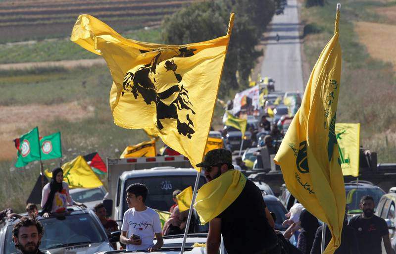 Supporters of Lebanon's Hezbollah leader Sayyed Hassan Nasrallah ride in a convoy marking Resistance and Liberation Day, in Kfar Kila village, near the border with Israel, southern Lebanon, May 25, 2021. REUTERS/Aziz Taher