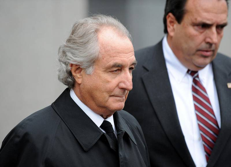 (FILES) In this file photo disgraced Wall Street financier Bernard Madoff leaves US Federal Court after a hearing on March 10, 2009 in New York. Madoff has agreed to plead guilty to 11 counts of fraud, his lawyer said in court.   Bernie Madoff, the mastermind behind the worst financial scam in history, has died in prison at age 82, US media reported on April 14, 2021. Madoff was sentenced to 150 years in prison in 2009 for running a pyramid-style scheme that defrauded tens of thousands of people around the world.The scheme was estimated to be worth anywhere between $25 billion and $63 billion. / AFP / STAN HONDA