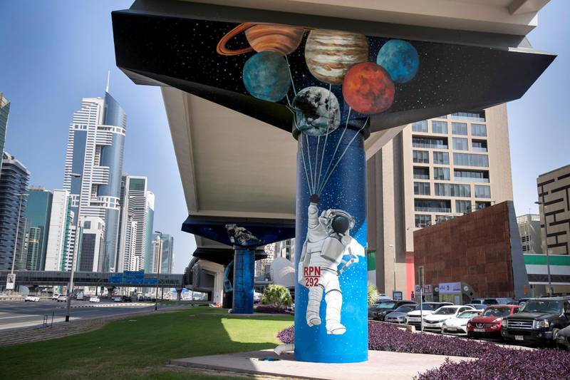 DUBAI, UNITED ARAB EMIRATES - NOVEMBER 12, 2018. The Dubai Metro Murals Project.This initiative, run by Brand Dubai, will see some of the pillars that hold up the Dubai Metro painted by two international artists, Peruvian Daniel Cortez and Dominican-born, Miami-based Elio Mercado, known as Evoca1. These two artists will paint the pillars in between the DIFC and Emirates Towers stations.(Photo by Reem Mohammed/The National)Reporter: Section:  NA