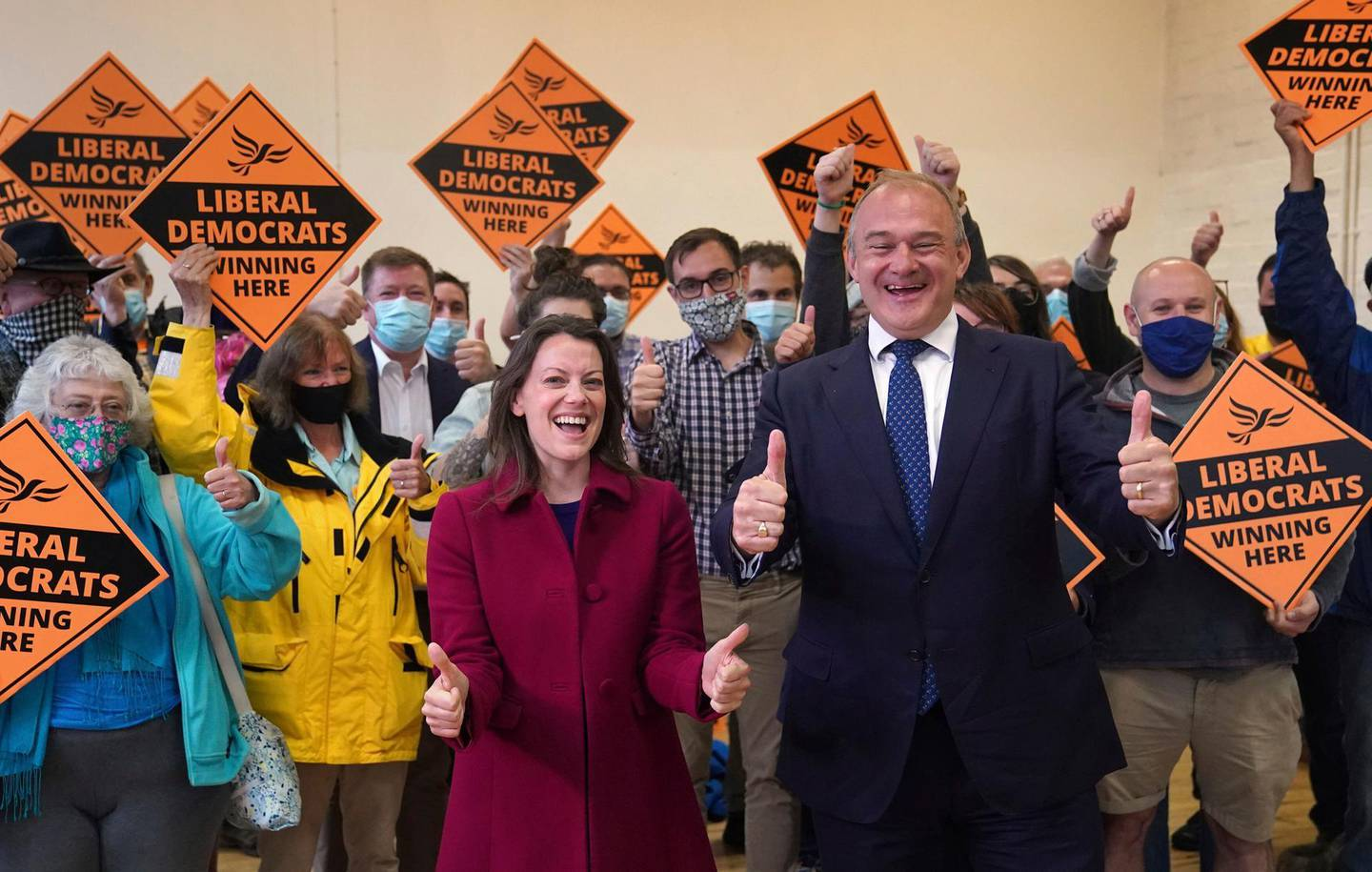 Liberal Democrat leader Ed Davey and new Liberal Democrat MP for Chesham and Amersham Sarah Green during a victory rally at Chesham Youth Centre in Chesham, England, Friday June 18, 2021, after Sarah Green won the Chesham and Amersham by-election. In a surprising result, Prime Minister Boris Johnson's Conservative Party was easily defeated in a special election for a seat it has held onto for decades. (Steve Parsons/PA via AP)