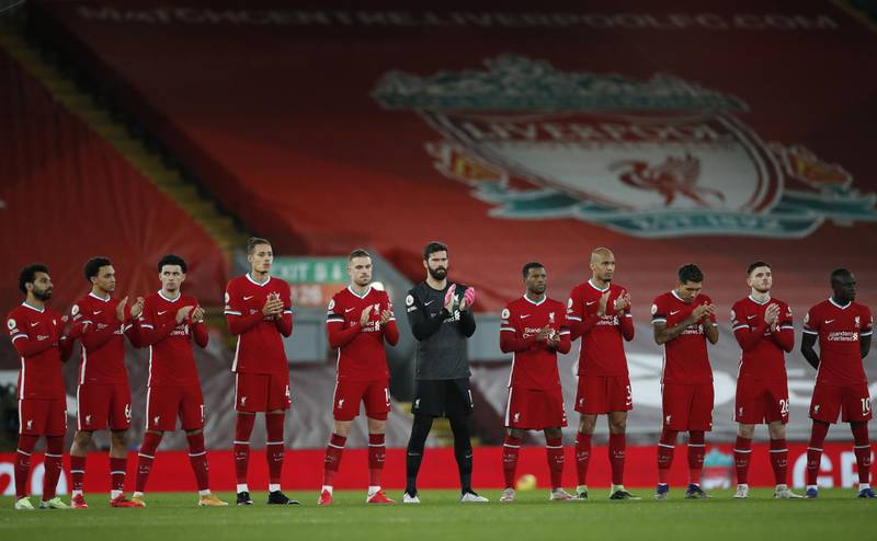 epa08889082 Liverpool players observe a minute applause in memory of former Liverpool manager Gerard Houllier during the English Premier League soccer match between Liverpool FC and Tottenham Hotspur in Liverpool, Britain, 16 December 2020.  EPA/Clive Brunskill / POOL EDITORIAL USE ONLY. No use with unauthorized audio, video, data, fixture lists, club/league logos or 'live' services. Online in-match use limited to 120 images, no video emulation. No use in betting, games or single club/league/player publications.
