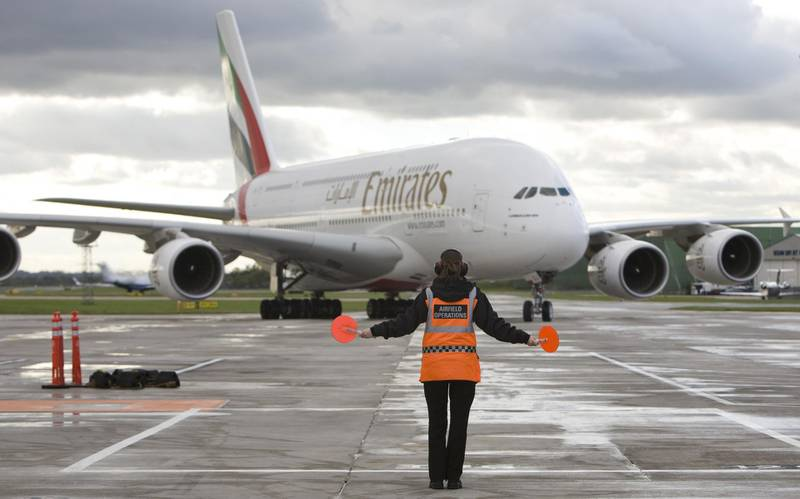 FILE: An Emirates Airline Airbus A380 airplane is directed on to a stand at Manchester airport in Manchester, U.K., on Thursday, Oct. 21, 2010. Airbus SE decided to stop making the A380 double-decker after a dozen years in service, burying a prestige project that won the hearts of passengers and politicians but never the broad support of airlines that instead preferred smaller, more fuel-efficient aircraft. Production of the jumbo jet will end by 2021, after the A380's biggest customer, Emirates, and a handful of remaining buyers receive their last orders. Photographer: Chris Ratcliffe/Bloomberg