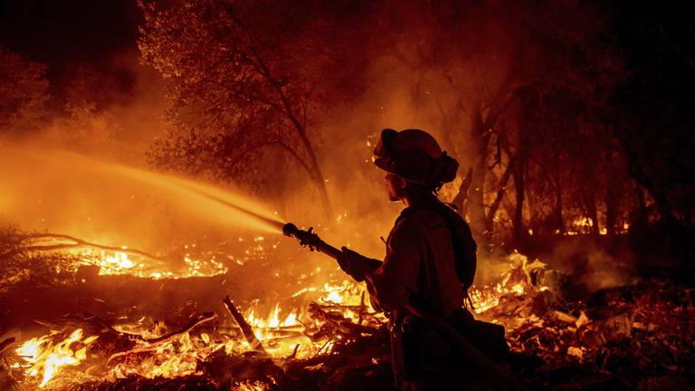 An image that illustrates this article Woman charged with arson as bushfire forces evacuations in California