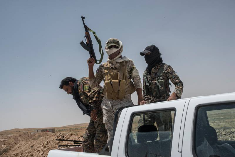 NINEVEH, IRAQ - JUNE 20: Iraqi PMF fighters on June 20, 2017 on the Iraq-Syria border in Nineveh, Iraq. The Popular Mobilisation Front (PMF) forces, composed of majority Shi'ite militia, part of the Iraqi forces, have pushed Islamic State militants from the north-western Iraq border strip back into Syria. The PMF now hold the border, crucial to the fall of Islamic State in Mosul, blocking the Islamic State supply route for militants from Syria to Mosul. (Martyn Aim/Getty Images).