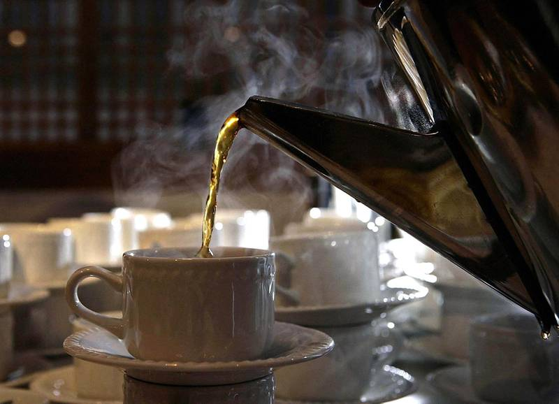 The 'perfect cup of tea' being poured at The Royal Society of Medicine. PA Images via Reuters