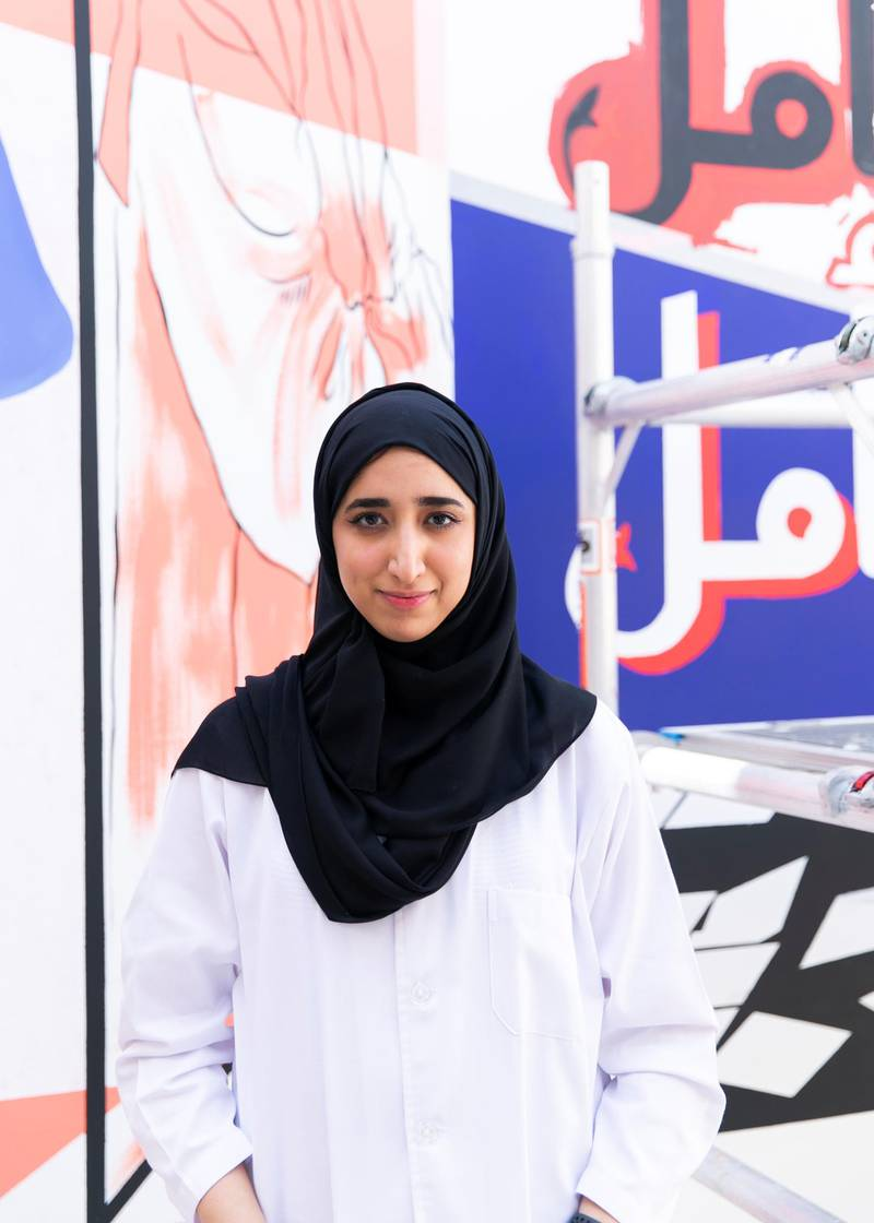 """DUBAI, UNITED ARAB EMIRATES. 25 JULY 2020. Artist Reem Al Mazrouei works on their commission for Dubai Culture. They are painting a """"Hope mural"""" to celebrate the UAE Mars mission in Dubai's Al Fahidi district. (Photo: Reem Mohammed/The National)Reporter:Section:"""