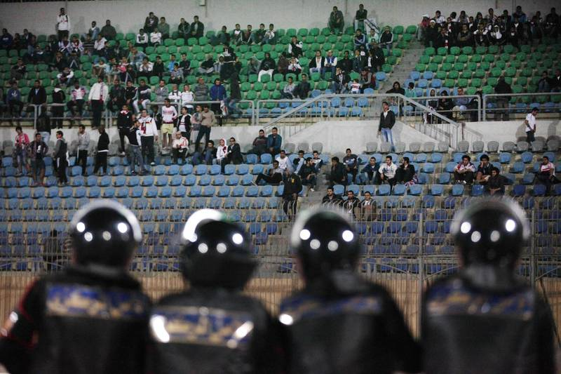 In this Sunday, Feb. 8, 2015 photo, Egyptians watch a match between Egyptian Premier League clubs Zamalek and ENPPI at the Air Defense Stadium in a suburb east of Cairo, Egypt. Egypt's Cabinet has indefinitely suspended the national soccer league after more than 20 fans were killed in a stampede and clashes with police outside the Cairo stadium. (AP Photo/Ahmed Abd El-Gwad, El Shorouk Newspaper) EGYPT OUT